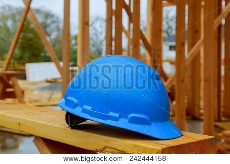 Construction Work Safety Helmets For Professional Builders Are Placed On Wooden Boards.safety Helmet