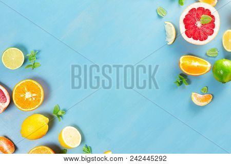 Citrus Food Frame Flat Lay Scene On Blue Background - Assorted Citrus Fruits With Mint Leaves