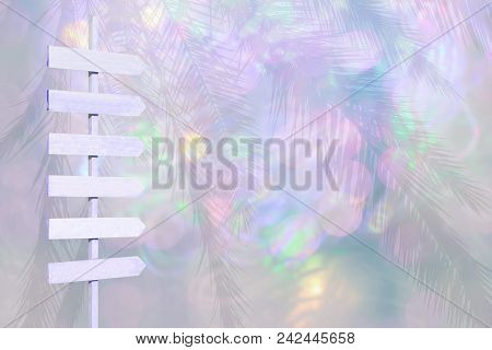 Violet Color Wood Arrow Signpost On Blurry Lights Soft Pink Green Pastel Color Background Bokeh Text