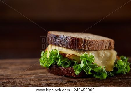 Tasty And Fresh Sandwiches On Cuttig Board Over A Dark Wooden Background, Close-up. Yummy Sandwich W