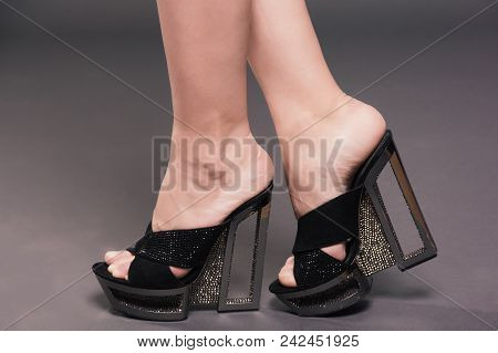 Fashionable Woman Slender Legs In Tights Black Stylish High Heels Shoes With Rhinestones On Backgrou