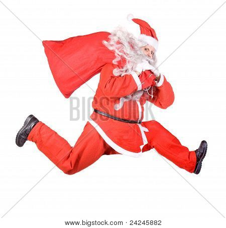 Santa Claus is running with a bag