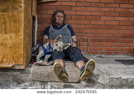 Two Homeless Fiends - Man And Dog Sleeping While Sitting On A Concrete Against Brick Wall