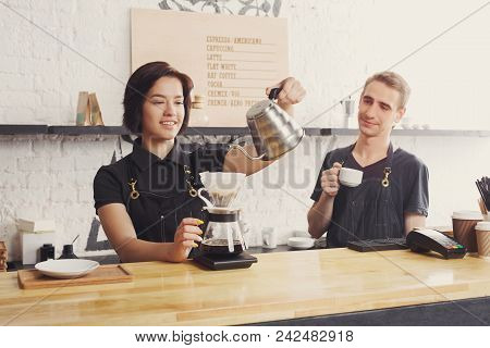 Coffee Business Background With Copy Space. Portrait Of Two Young Bartenders Preparing Fresh Pourove