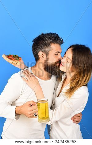 Happy Family Time. Husband And Wife Eating Pizza. Couple Sharing Pizza And Eating Together Happily.