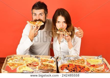 Happy Family Time - Couple Enjoying Pizza. Leisure, Food&drinks, People, Holidays Concept - Smiling