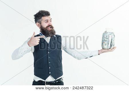 Business Man, Millionaire, Billionaire. Finance. Bearded Man Points On Jar With Money. Saving Money