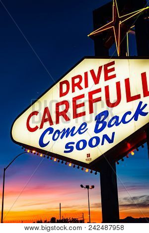 Drive Carefully: Come Back Soon Sign At Sunrise, Nevada