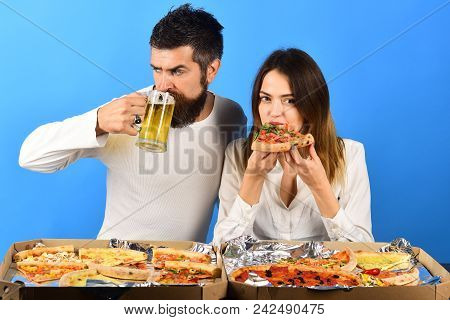 Happy Family, Lovable Couple Eating Pizza Together. Love, Food&drinks Concept - Husband Drinking Bee
