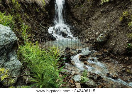Small Mountain River Waterfall. Mountain River Cascade. Small Cascade In The Mountain. Mountain Casc