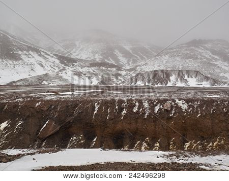 Mountains High Atlas During A Snowfall, Peaks Hides A White Fog, Morocco.