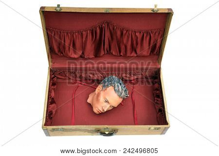 Vintage Suitcase with antique mannequin head. Antique suitcase with a 1920's era mannequin head. Isolated on white. room for text.