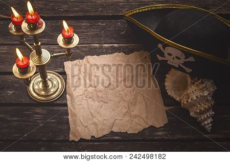 Blank Crumpled Paper Page With Copy Space For Pirate Treasure Map On Captain Table With Pirate Hat,