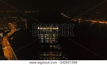 Top View Of The Skyscraper In Hong Kong At Night. Stock. Beautiful View Of The Tall Skyscraper In Th