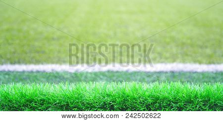 Front View Of Green Soccer Field.beautiful Artificial Grass On The Stadium.abstract Football Turf Gr