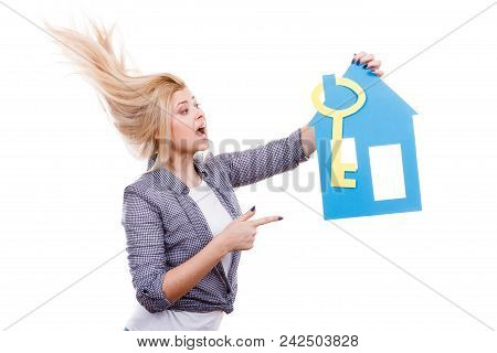 Dream About Stabilization, Plans For Future. Blonde Girl Holding Blue Paper House Model And Yellow K