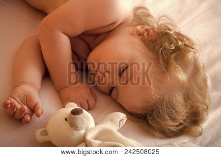 Child Childhood Children Happiness Concept. Closeup View Of Lovely Small Sleeping Boy Child With Blo