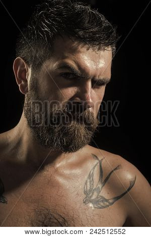 Man With Serious Emotion. Man With Long Beard On Serious Face With Naked Shoulder On Black Backgroun