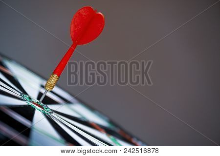Close Up Shot Red Darts Arrows In The Target Center On Dark Background. Business Target Or Goal Succ