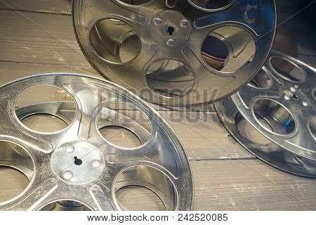 35mm Film Reels Empty Without Film On Wood Floor