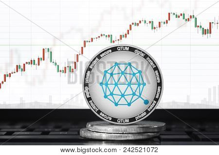 Qtum Cryptocurrency; Qtum Coin On The Background Of The Chart