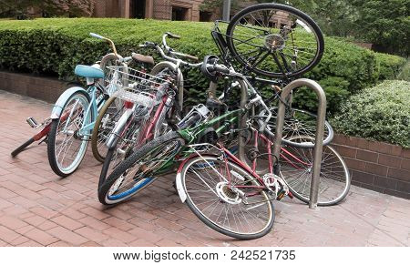 Jumbled Messy Collection Of Locked Bicycles Outside