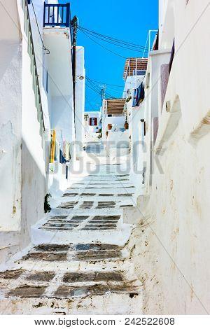 Old uphill street in Mykonos - Chora town, Greece