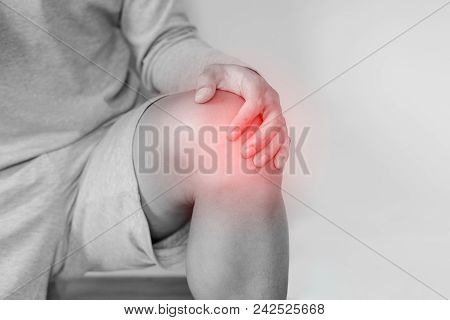 Knee Joint Pain, A Man Touching Knee And Suffering From Knee Pain