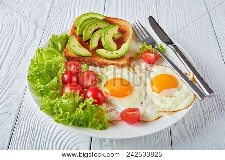 Fried Eggs, Fresh Salad, Toast. Close-up