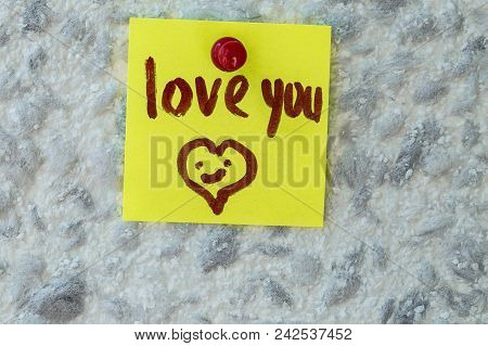 Love You  Text Written On Sticky Note On Gray Background. Motivational Quotes