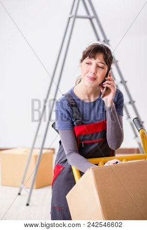 Woman contractor moving boxes in relocation concept poster