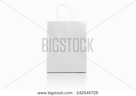 Empty Shopping Bag On Background For Advertising And Branding. White Paper Package Isolated For Corp