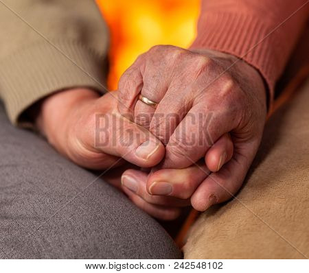 Senior Hands Of Man And Woman Holding - Resilience And Commitment Concept