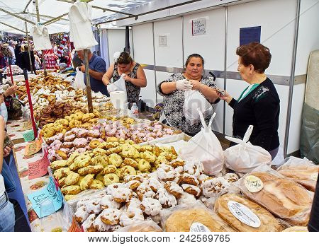 Bakers Selling Rosquillas Del Santo At The San Isidro Fair.