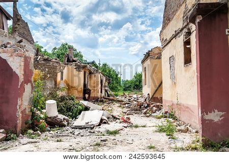 Aftermath catastrophe after hurricane or war disaster damaged and ruined house property with moody and dark sky poster