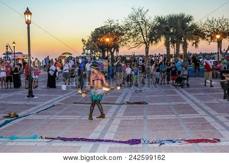 Key West, Florida, United States - April 12, 2012: Fire Eater Walking On Hot Coals During The Sunset