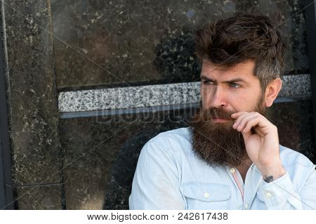 Man With Beard And Mustache On Concentrated Face, Black Marble Background. Guy Looks Interested And