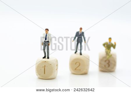 Miniature People : Businessman Standing On Wooden Blocks With Sequential Numbers '1, 2, 3', Win And