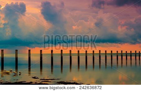 Echos In The Stream: Wooden Pilings In The Atlantic Ocean At Sunrise, Islamorada, Florida