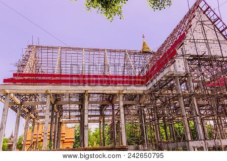 Thai Buddhist Church In Local Of Thailand Under Construction Against The Blue Sky Background