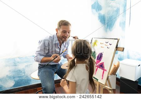Happy Father's Day.funny Portrait Of Smiling Father And Her Daughter Painting With Watercolor On Eas