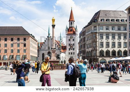 Munich, Germany - May 23, 2018: People On Marienplatz Square And View Of Old Town Hall In Munich Cit