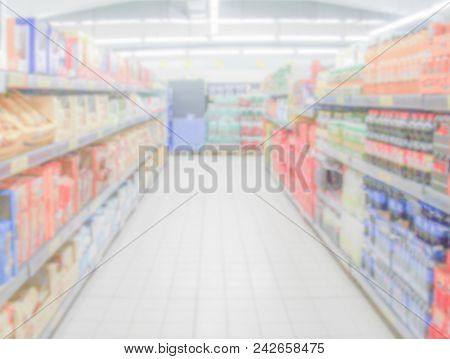 Defocused Background Within The Aisles Full Of Grocery Goods In A Supermarket Or Hypermarket Conveni
