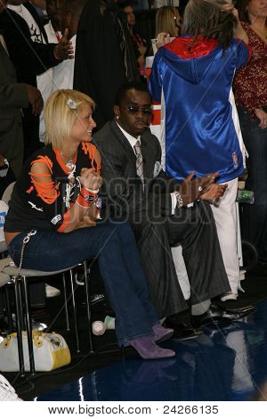 LOS ANGELES - FEB 13: Paris Hilton, P Diddy aka Sean Combs at the NBA All Star Celebrity Game on February 13, 2004 at the Los Angeles Convention Center in Los Angeles, California