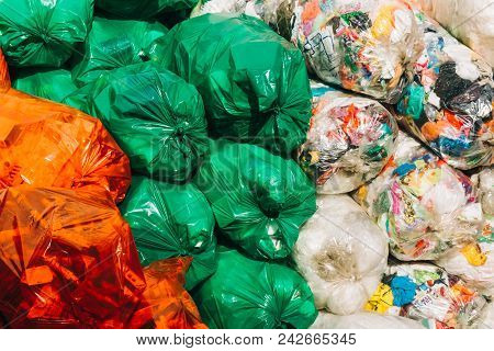 Separate Collection Of Garbage On Colorful Packages, Secondary Processing Of Plastic.