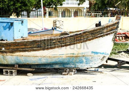 Fishing Boat In Repair On The Coast. Greece