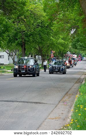 West Saint Paul, Mn/usa - May 19, 2018: Parade Motorcade Fills Street Of Residential Neighborhood Du
