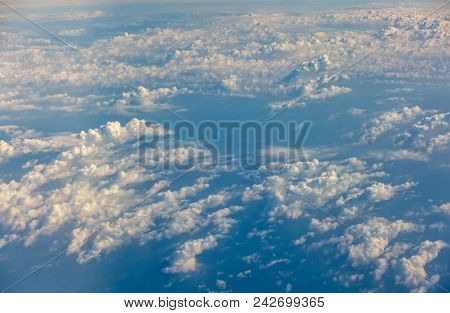 Top View Of Sunrise Above Clouds From Airplane Window , Traveling Concept.