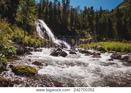 A Beautiful Waterfall In The Forest. Wildlife, Waterfalls In A Deserted Forest. Taiga. Strong And Ta