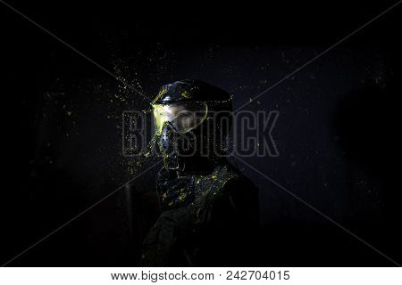Paintball Mask Zoomed In On.splashes After Direct Hit To Protecting Mask In The Paintball Game.the P